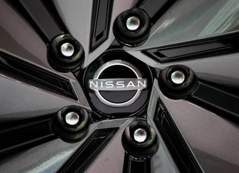 The brand logo of Nissan Motor Corp. is seen on a tyre wheel of the company's car at their showroom in Tokyo