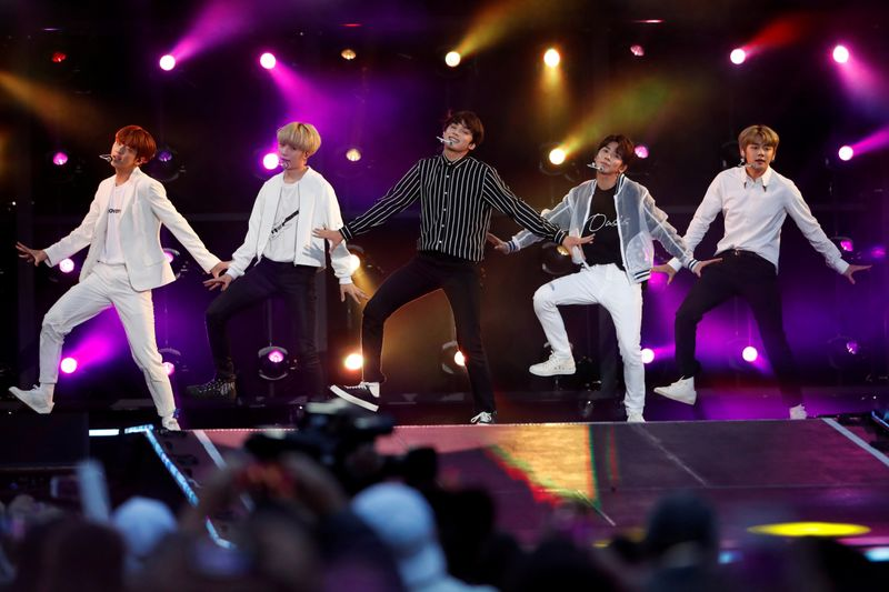 FILE PHOTO: Tomorrow X Together (TXT) perform at the iHeartRadio Wango Tango concert in Carson