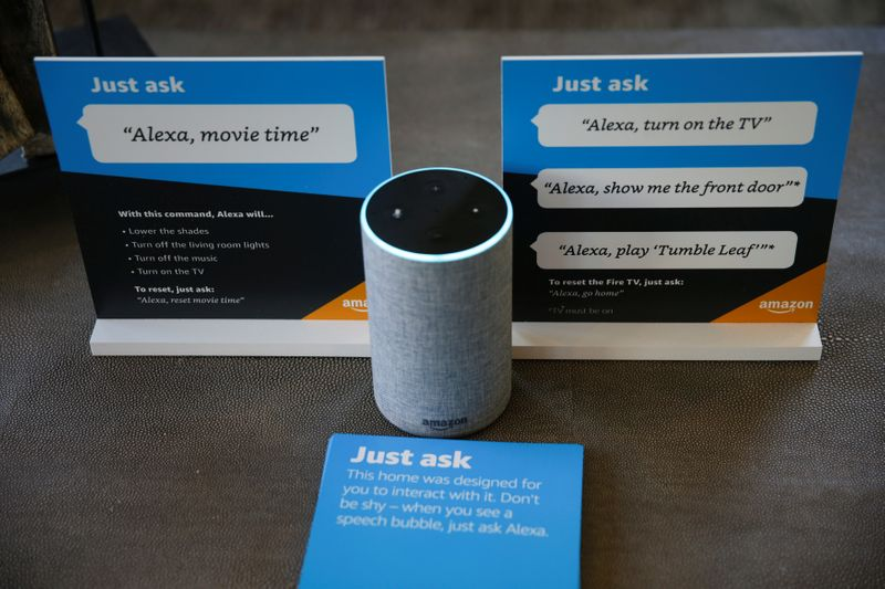 FILE PHOTO: Prompts on how to use Amazon's Alexa personal assistant are seen alongside an Amazon Echo in an Amazon 'experience center'  in Vallejo