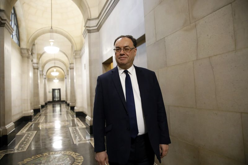 FILE PHOTO: Bank of England Governor Andrew Bailey poses for a photograph on the first day of his new role at the Central Bank in London