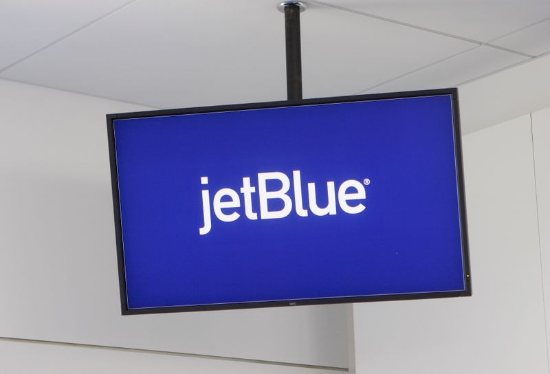 FILE PHOTO: JetBlue Airways logo is displayed on a monitor in Terminal 5 at JFK International Airport in New York