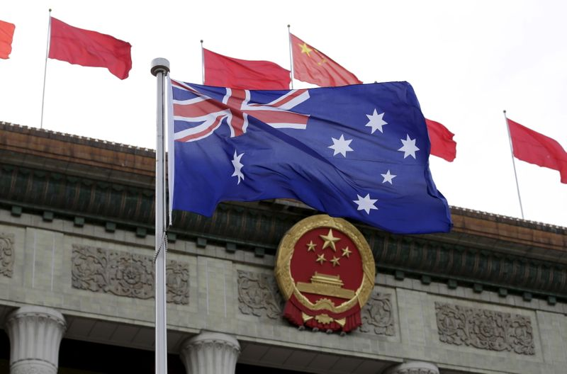Australian flag waves in front of the Great Hall of the People in Beijing