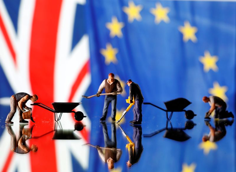 Small toy figures are seen in front of UK and European Union displayed flags in this illustration picture,