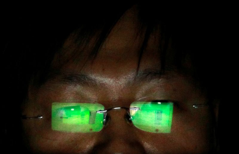 FILE PHOTO: A hacker works on his laptop in Taipei