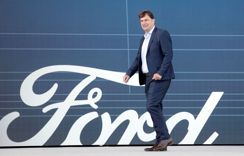 FILE PHOTO: Ford Motor Co. CEO Jim Farley walks to speak at a news conference at the Rouge Complex in Dearborn, Michigan