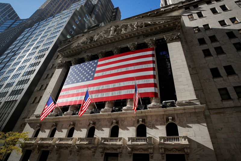 FILE PHOTO: The U.S. flag covers the front facade of the NYSE in New York