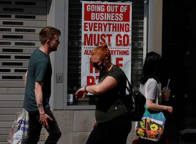 People walk past a closed shop following the outbreak of the coronavirus disease (COVID-19) in Chester, Britain