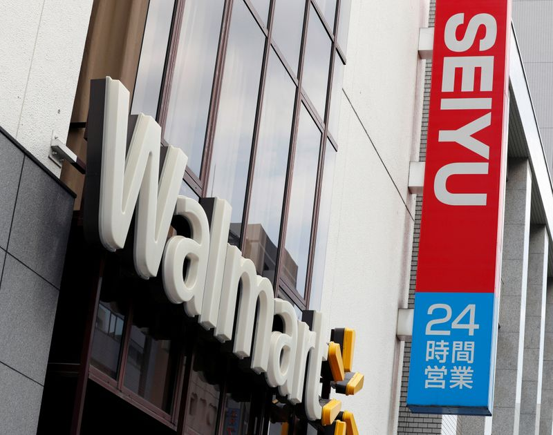 Logos of Walmart and Seiyu are pictured at the headquarters office in Tokyo