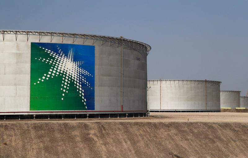 FILE PHOTO: A view shows branded oil tanks at the Saudi Aramco oil facility in Abqaiq