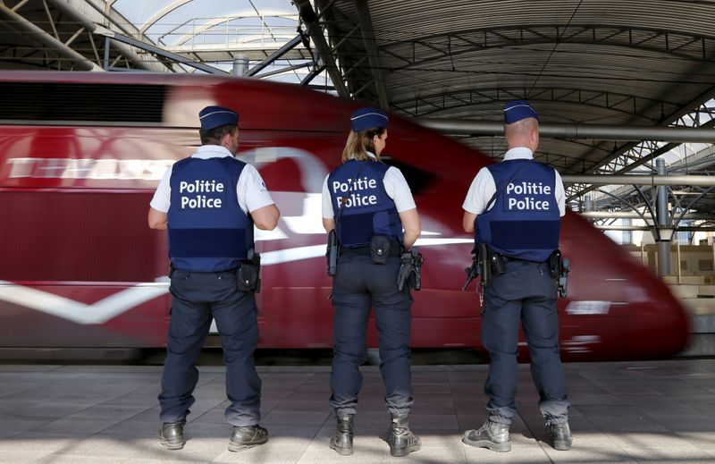 FILE PHOTO: Belgian police officers stand guard on a platform at the Thalys high-speed train terminal at Brussels Midi/Zuid railway station