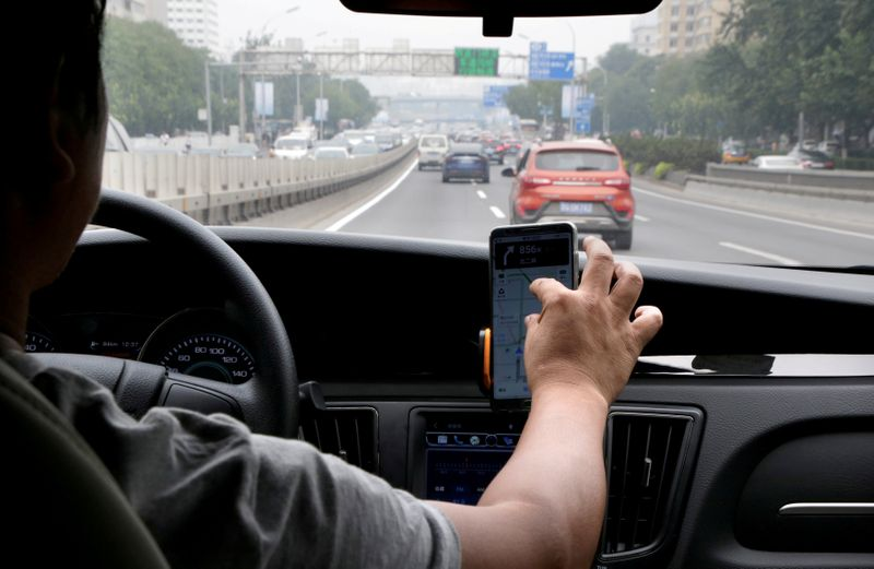 FILE PHOTO: A Didi Chuxing driver on the road in Beijing