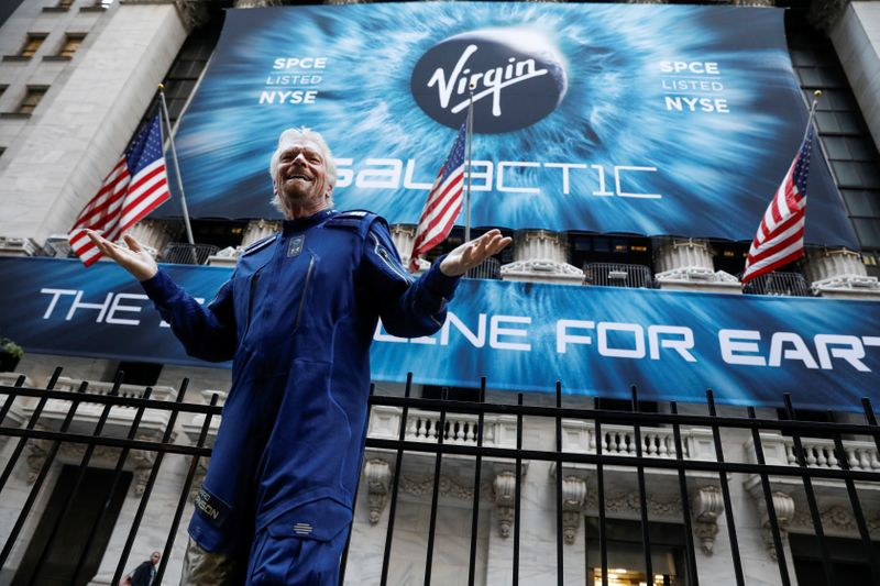 FILE PHOTO: Sir Richard Branson stands outside the New York Stock Exchange (NYSE) ahead of Virgin Galactic (SPCE) IPO in New York