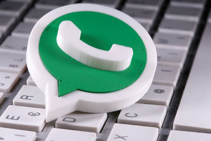 FILE PHOTO: A 3D printed Whatsapp logo is placed on the keyboard in this illustration taken