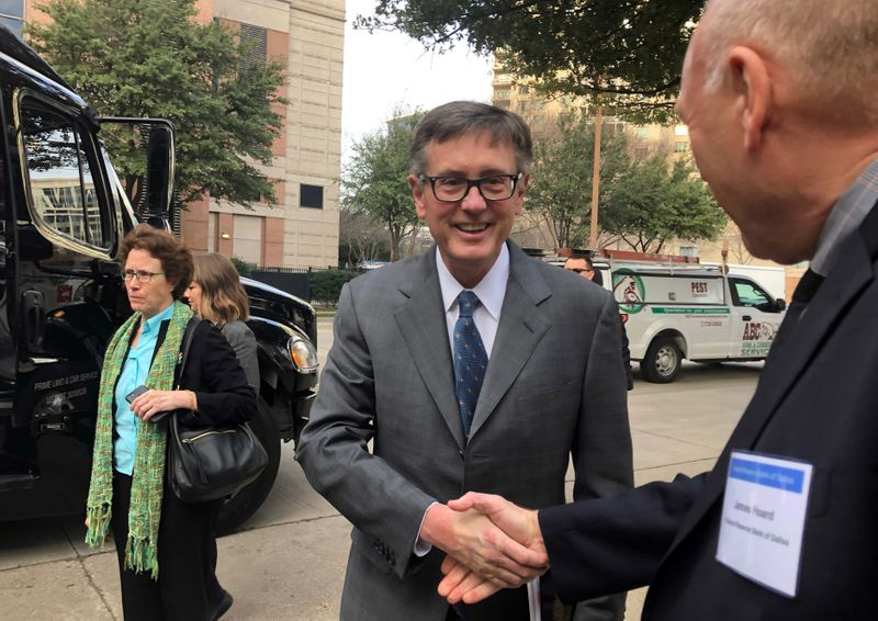 aoFederal Reserve Vice Chairman Clarida greets a member of the Dallas Fed staff in Dallas
