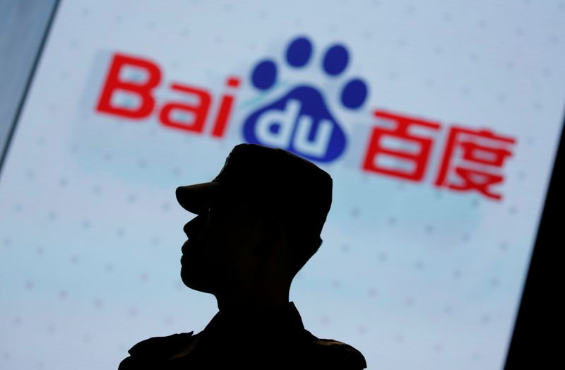 A security personnel stands guard at the opening session of Baidu's annual AI developers conference in Beijing