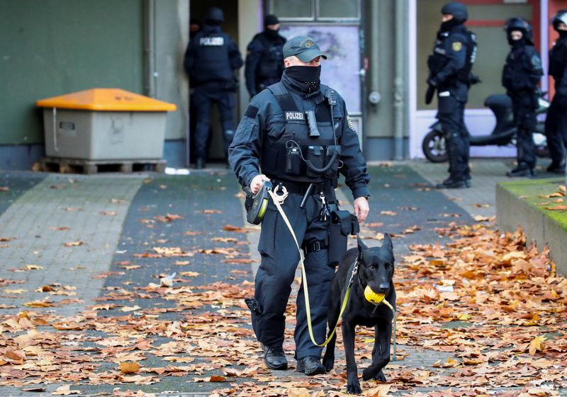 German police secure the area during raids in Berlin