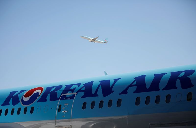 FILE PHOTO: The logo of Korean Airlines is seen on a B787-9 plane at its aviation shed in Incheon, South Korea