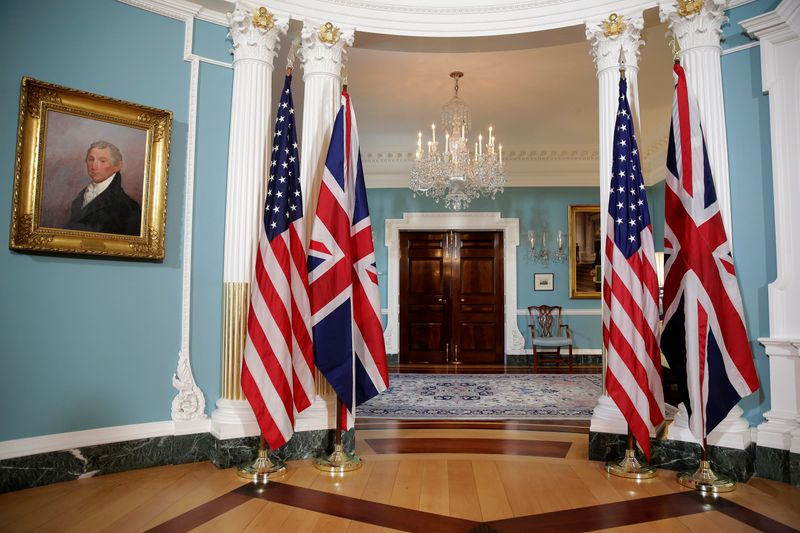 The flags of the United States and the United Kingdom stand after bi-lateral photo between U.S. Secretary of State Rex Tillerson and British Foreign Minister Boris Johnson was cancelled at the State Department in Washington