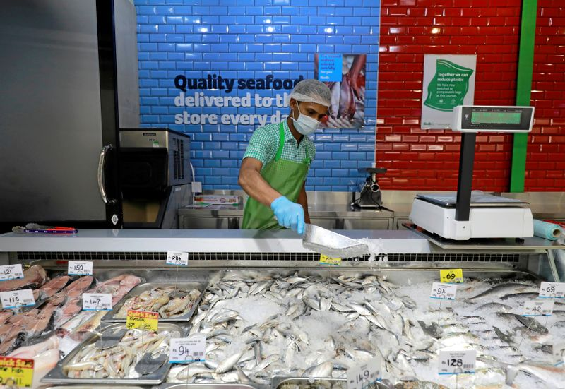 FILE PHOTO: A staff official wearing protective mask works at the meat and fish stall at a Keels super market, amid concerns about the spread of the coronavirus disease, in Colombo