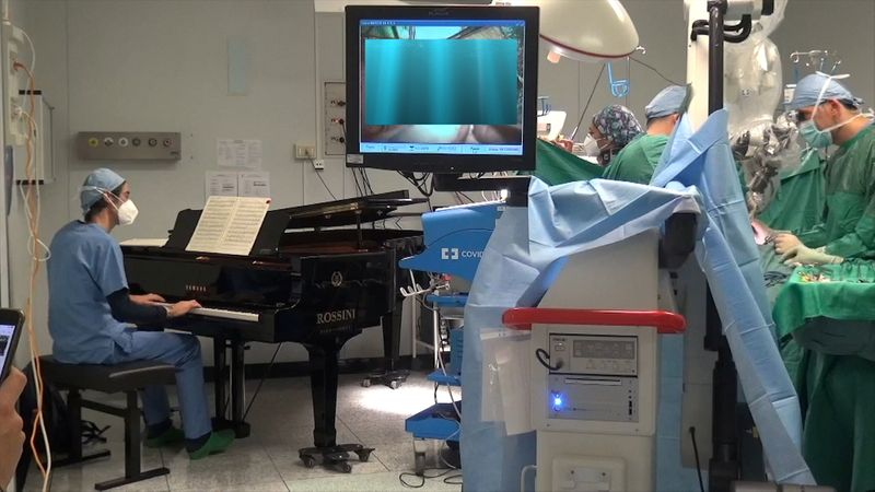 Boys has surgery as piano played next to operating table