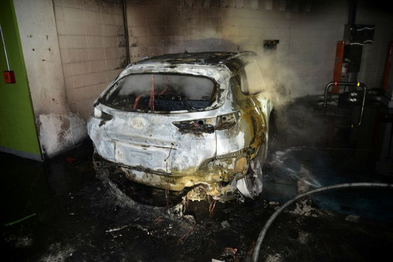 The burnt wreckage of a Hyundai Kona Electric vehicle is seen after it caught fire in Daegu, South Korea