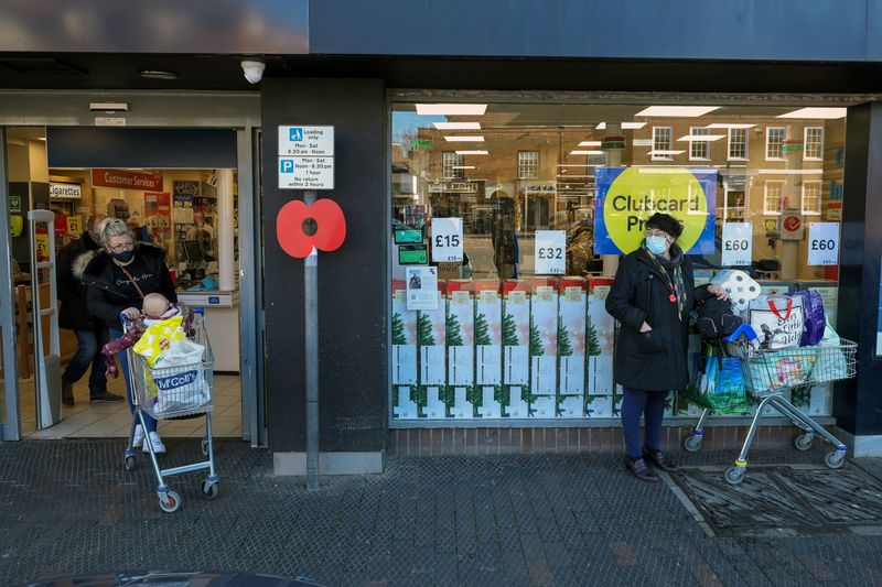 People stock up with items from a Tesco supermarket in West Malling