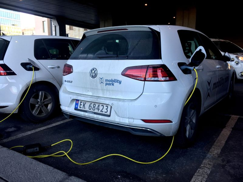 FILE PHOTO: Electric cars are parked in Oslo