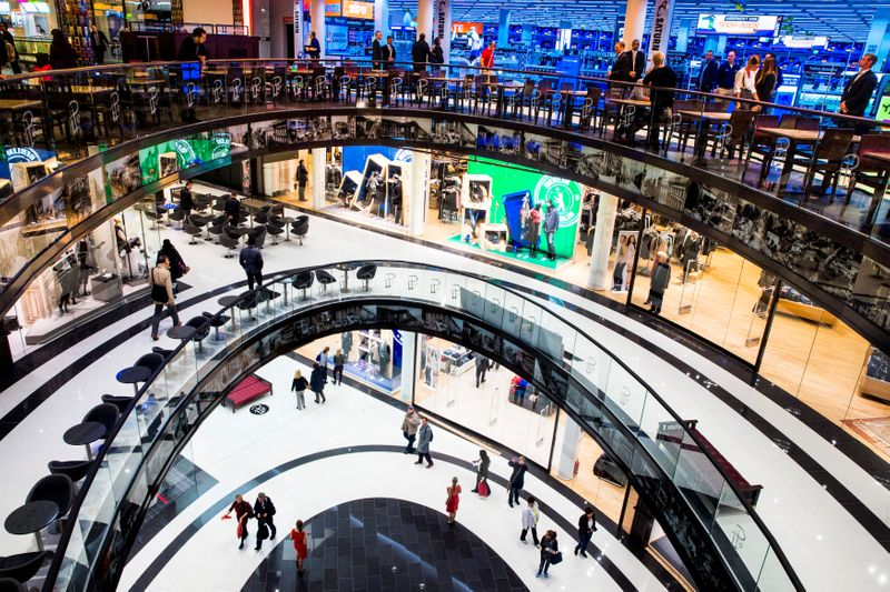 People walk through Mall of Berlin shopping centre during its opening night in Berlin