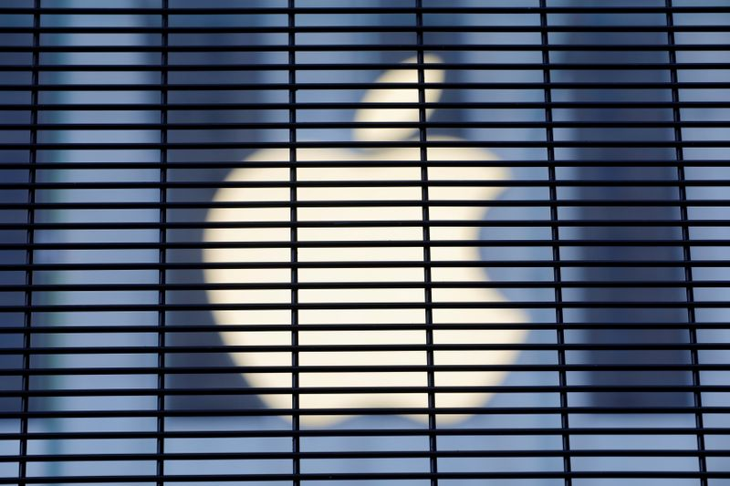 The Apple logo is seen through a security fence erected around the Apple Fifth Avenue store