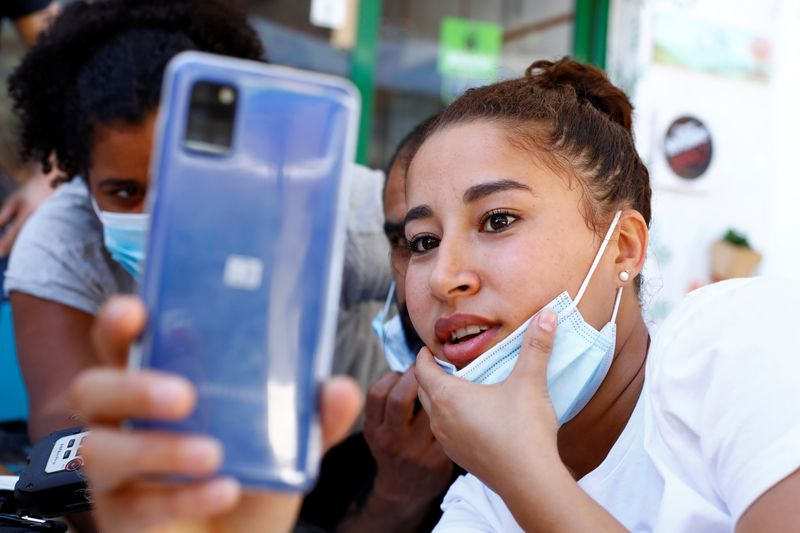 Sarah Bettache reacts during a video call with her brother Ahmed, a migrant from Morocco, in the port of Arguineguin