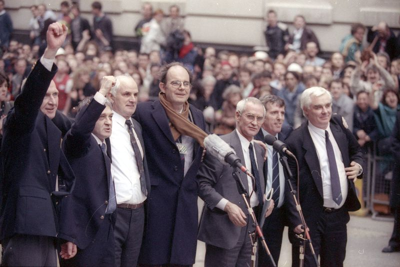 FILE PHOTO: Aquitted members of the Birmingham Six, sent to prison in 1975 for the IRA's bombing of two pubs, gather ...