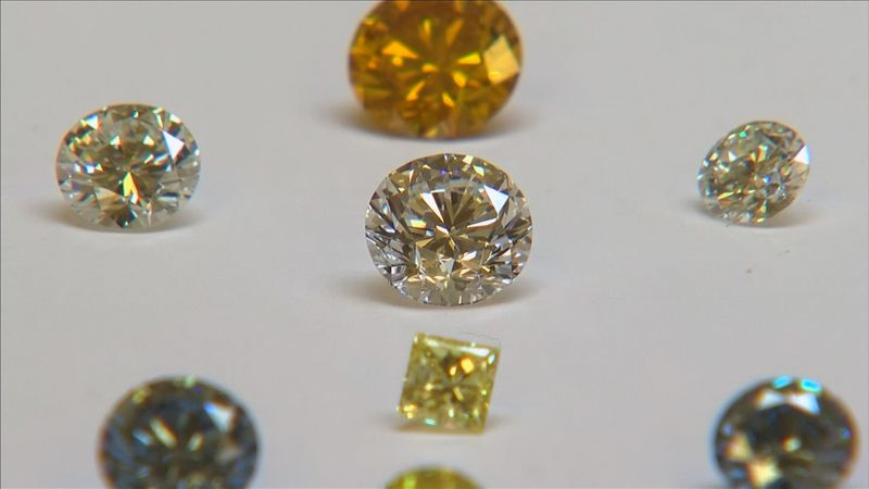 A still image from video shows coloured synthetic diamonds on display at De Beers' International Institute of Diamond Grading and Research in Maidenhead