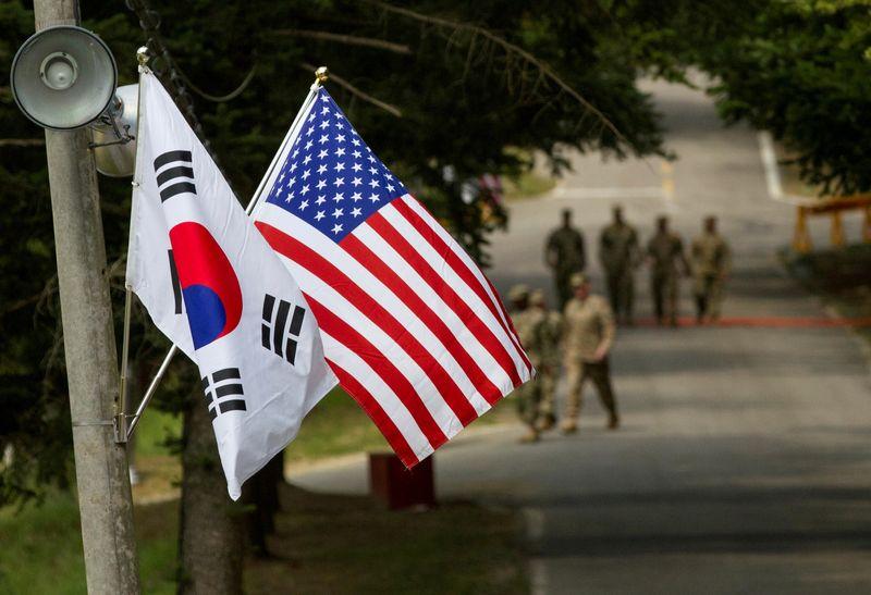 FILE PHOTO: American and South Korean flags at Yongin South Korea