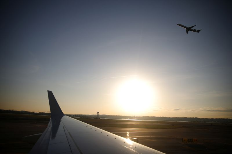 An airplane takes off from the Ronald Reagan National Airport as air traffic is affected by the spread of the coronavirus disease (COVID-19), in Washington