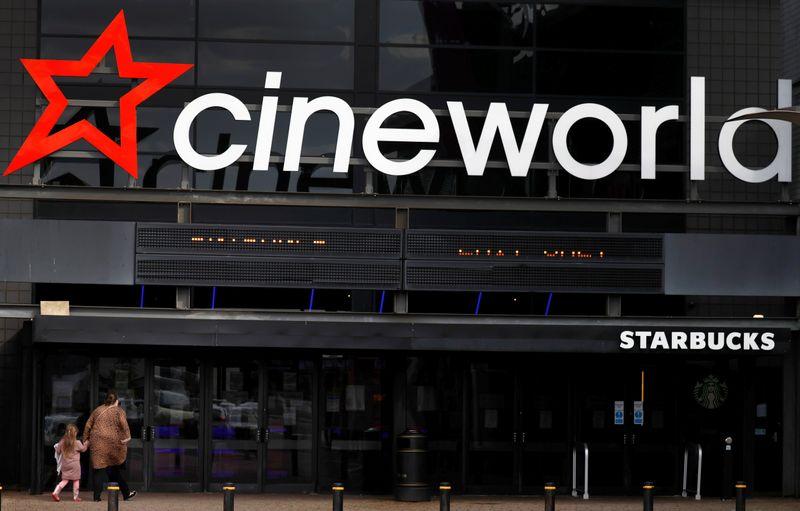 People enter a Cineworld cinema following the outbreak of the coronavirus disease (COVID-19) near Manchester