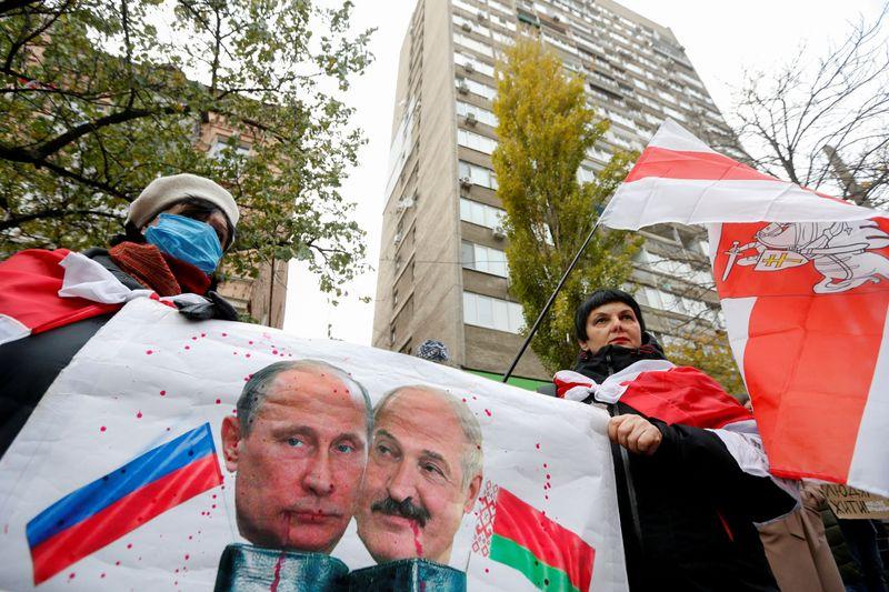 FILE PHOTO: People mourn the death of Belarusian anti-government protester Roman Bondarenko in Kyiv
