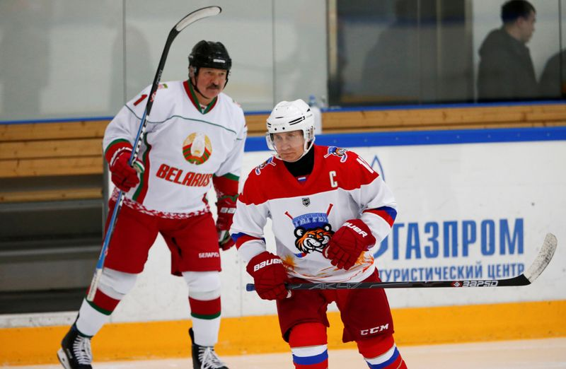FILE PHOTO: Russian President Vladimir Putin and Belarusian President Alexander Lukashenko take part in a match of the Night Hockey League teams in Rosa Khutor in the Black Sea resort of Sochi