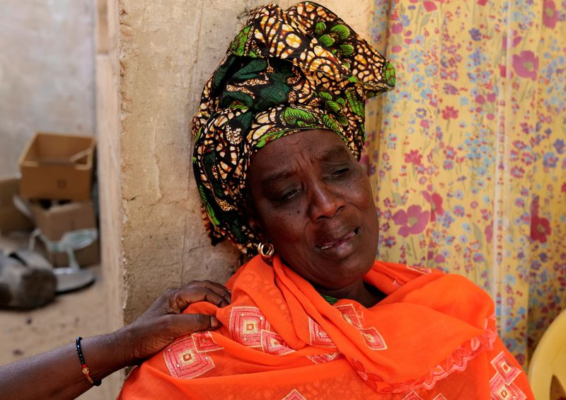 Gueye, whose son drowned at sea two weeks ago while trying to reach the Canary Islands, reacts during an interview with Reuters at her house in Tivaouane