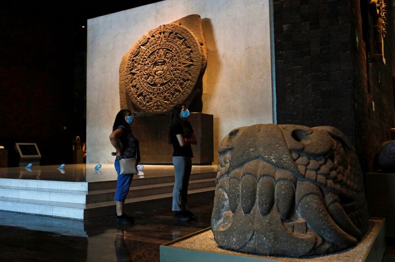 FILE PHOTO: People stand next to at the Aztec Sun Stone during a visit to the Mexico's National Museum of Anthropology, in Mexico City