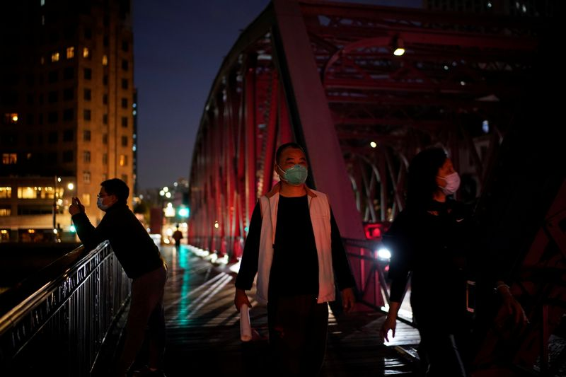 People wearing face masks are seen on a street amid the global outbreak of the coronavirus disease (COVID-19) in Shanghai