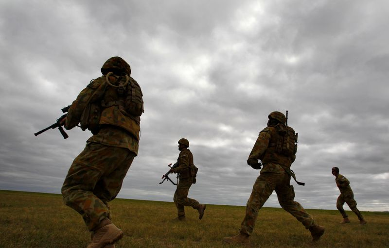 Members of Australia's special forces conduct an exercise during the Australian International Airshow in Melbourne