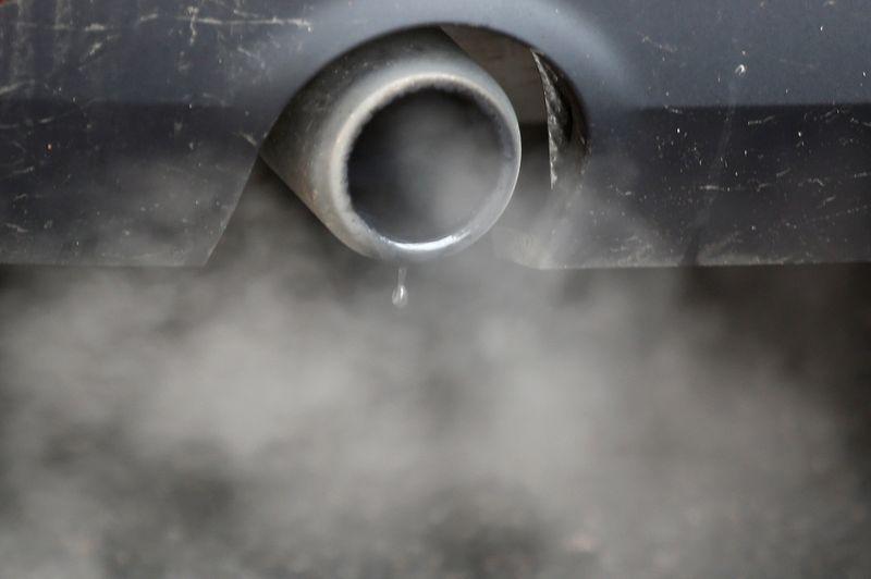 FILE PHOTO: An exhaust emits fumes as a car is driven through Richmond in London