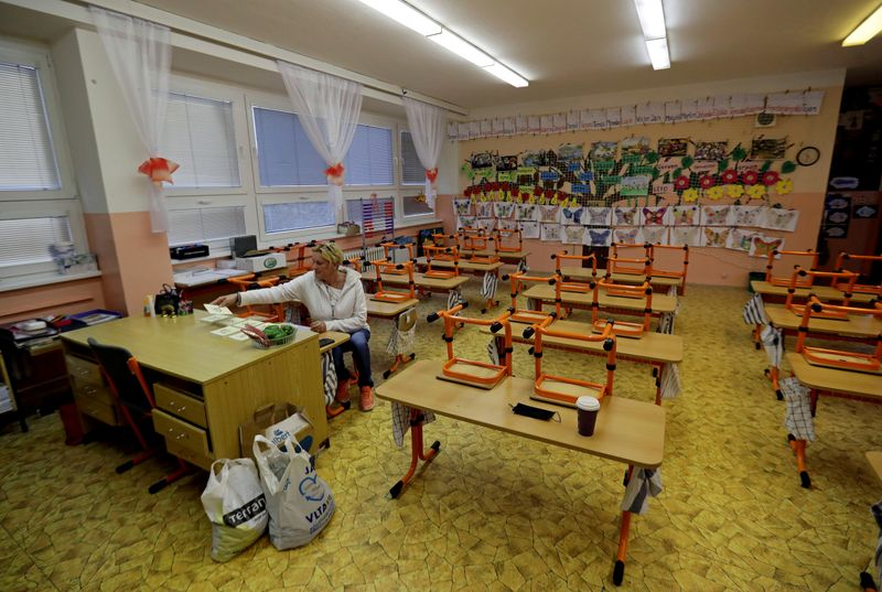 FILE PHOTO: Teachers at closed schools in Prague