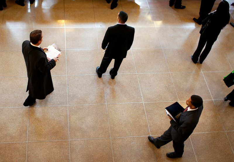 FILE PHOTO: Job seekers wait to meet potential employers at career fair at Rutgers University in New Brunswick