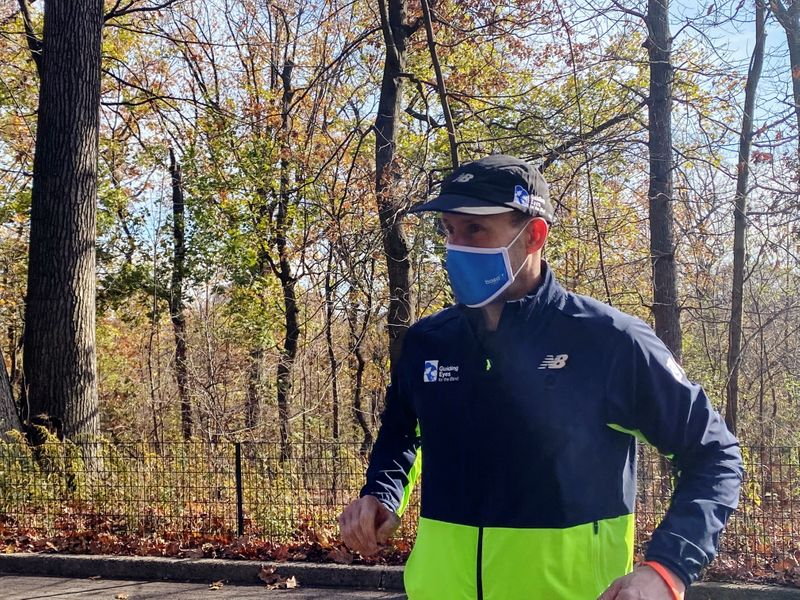Thomas Panek, a blind runner and CEO of Guiding Eyes for the Blind, gets ready for a 5K run in Central Park where he will use Google's