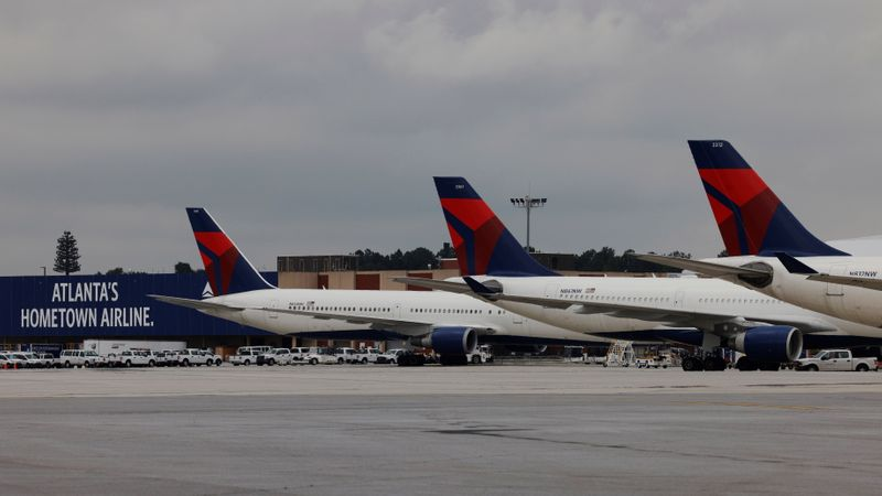 Delta Air Lines planes are parked at their gates in Atlanta