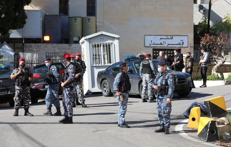 Members of the Lebanese police gather outside Baabda prison