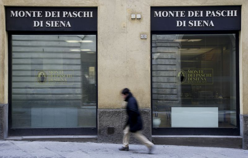 FILE PHOTO: A man walks in front of the Monte dei Paschi bank in Siena