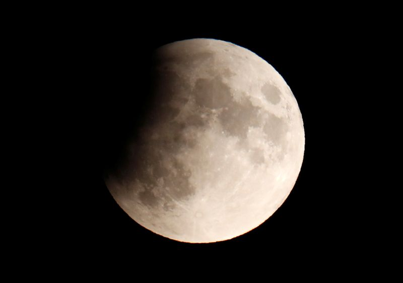 A partial lunar eclipse is seen in Berlin