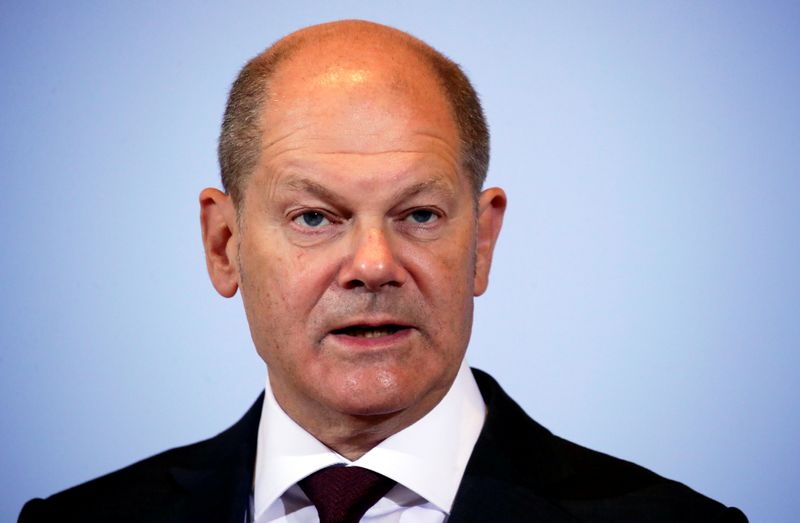 FILE PHOTO: German Finance Minister Scholz and Justice Minister Lambrecht hold news conference in Berlin